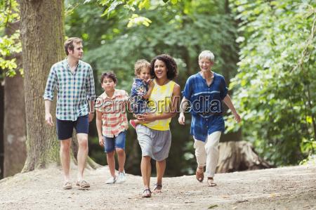 multi generation family walking in woods