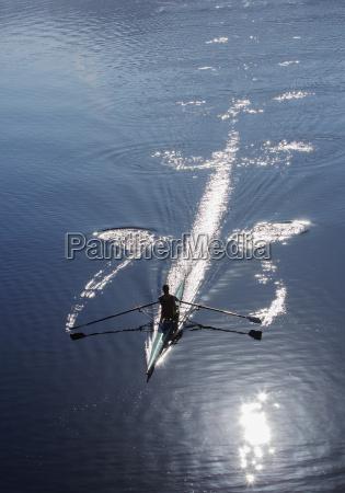 man rowing on lake