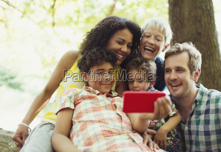 multi generation family taking selfie with