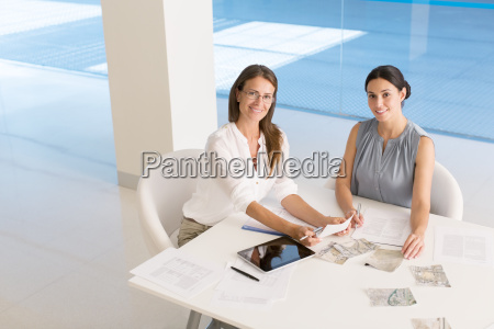 portrait of businesswomen at conference table