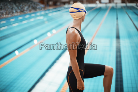 swimmer standing at poolside