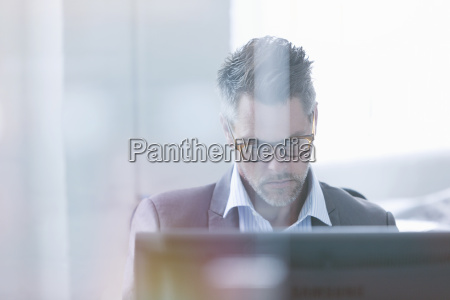 focused businessman using computer in office
