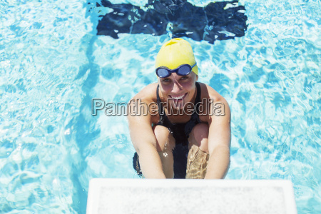 portrait of smiling swimmer poised at