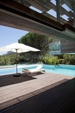 swimming pool lounge chair umbrella