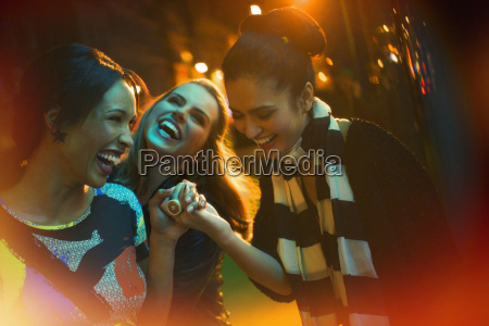 friends laughing on city street