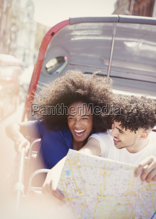 enthusiastic couple with map on double