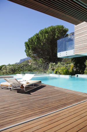 luxury swimming pool and lounge chairs