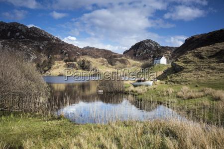 scenic view of sunny remote lake