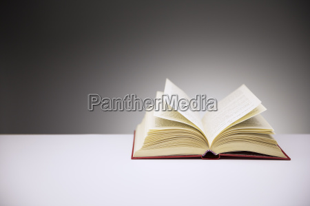 close up of open book on