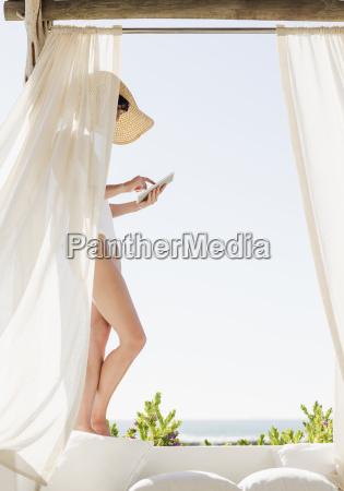 woman in bathing suit using digital