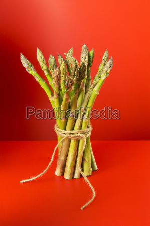 bunch of asparagus tied with string