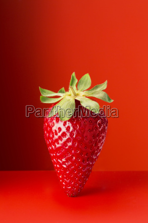 strawberry on red counter