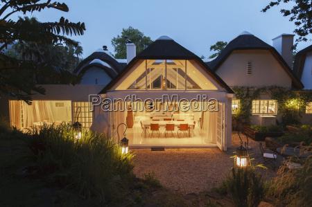 open modern house illuminated at night