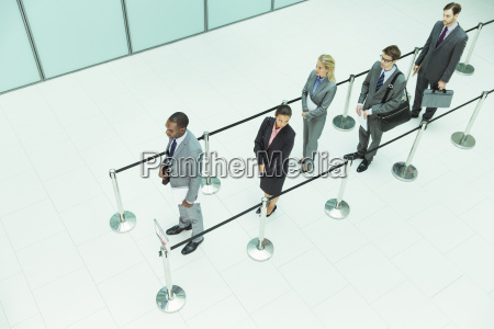 business people waiting in line