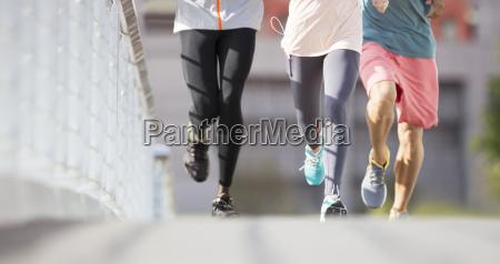 friends running through city streets