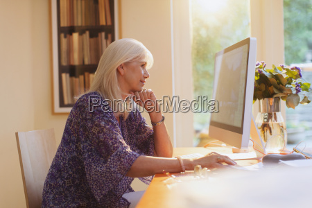 senior woman working at computer in