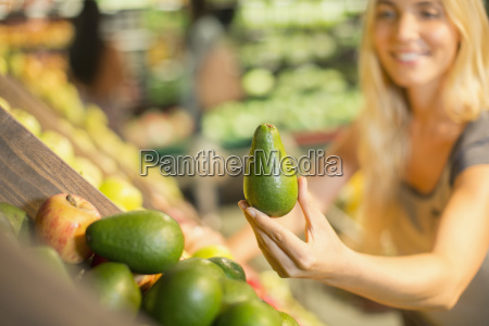 close up of woman holding produce