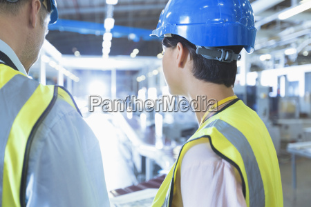 workers in reflective clothing and hard