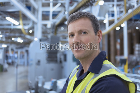 close up portrait confident worker in