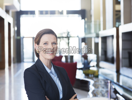 businesswoman smiling in lobby