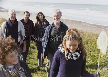 multi generation family walking on grassy