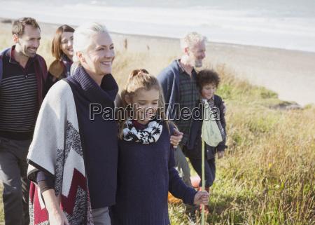 smiling multi generation family walking in