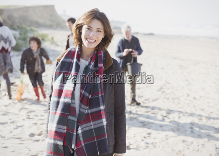 portrait smiling woman in plaid scarf