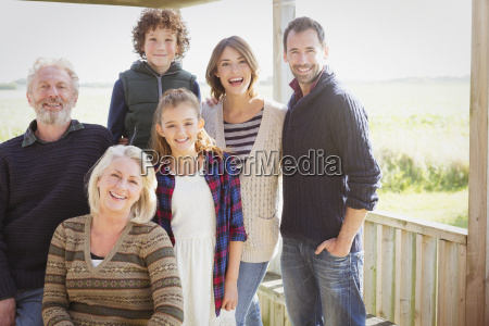portrait smiling multi generation family on