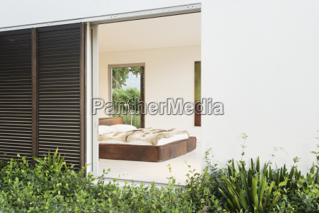 wood shutters and sliding door to