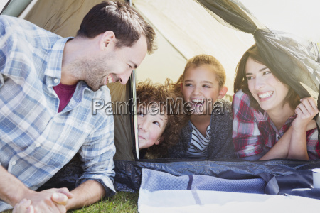smiling family in tent