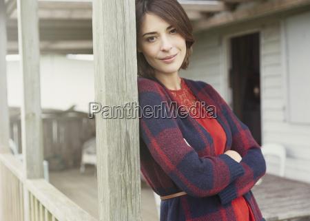 portrait smiling brunette woman in sweater