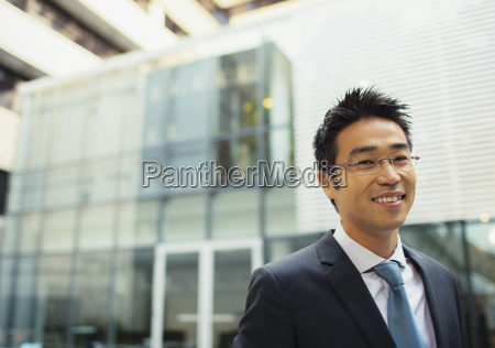 businessman outside of office building