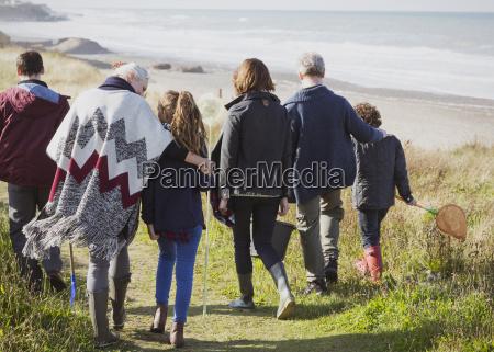multi generation family walking on sunny