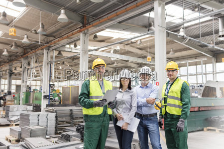 portrait confident engineers and workers in