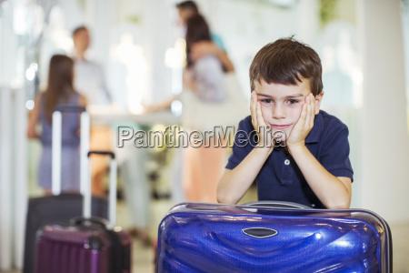 portrait of pensive boy leaning on