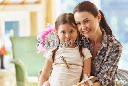 portrait smiling mother and daughter with