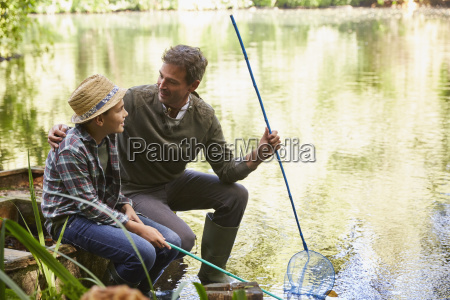father and son fishing with nets