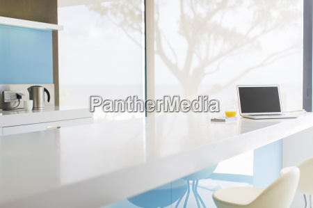 view of modern kitchen with laptop