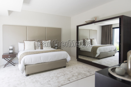white and beige modern bedroom with