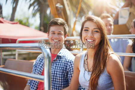 portrait smiling young couple on amusement