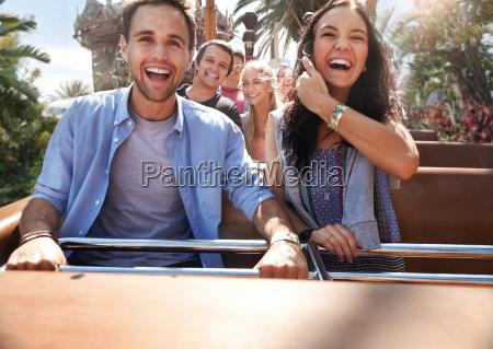 enthusiastic young couple riding amusement park