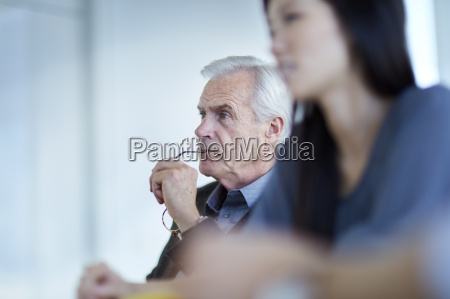 focused senior businessman listening in meeting