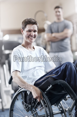 portrait smiling man in wheelchair at
