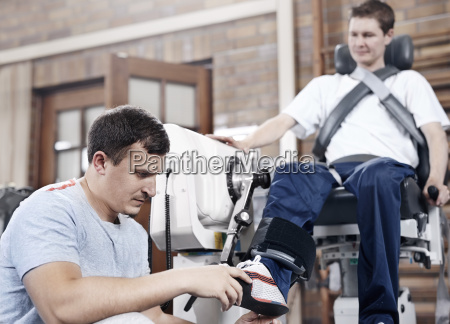 physical therapy checking mans foot