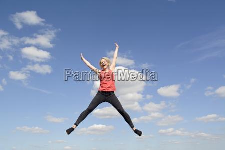woman makes joy jump