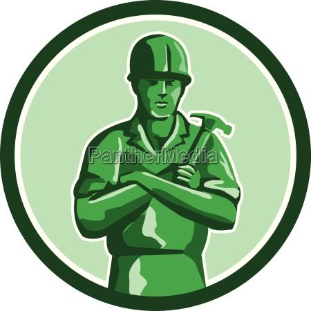 green builder holding hammer circle retro