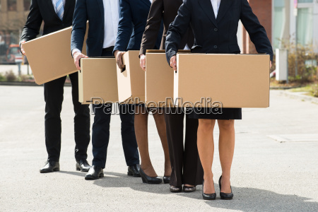businesspeople with cardboard boxes standing in
