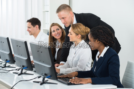 businessman helping his colleagues in the