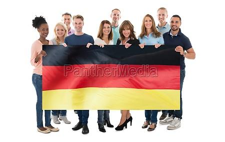 confident creative business team holding blank