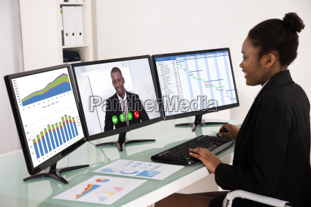 businesswoman working with multiple computer